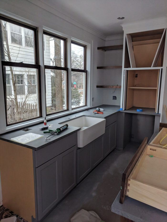The Countertop Goes In Over The Lower Cabinets Under The New Kitchen  Windows.